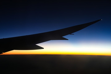 Beautiful view of Dreamliner plane wing flying into the darkness / last parts of sunset enroute to Brazil.