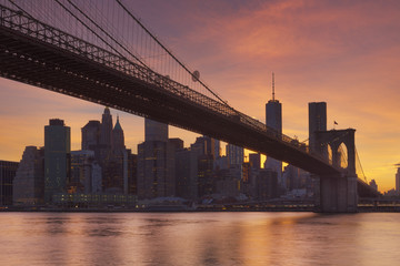 Brooklyn Bridge and New York City skyline at sunset
