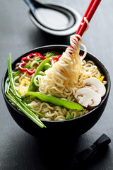 Closeup of tasty appetizing asian noodles soup with vegetables. Closeup. Toning.