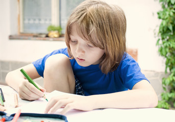Boy with Blond Drawing a Picture