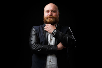 Satisfied man stroking ginger beard