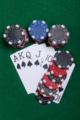 On the gaming table a set of royal flush picks, and a bet