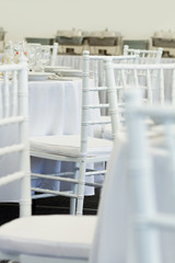 detail of white chairs, fancy wedding decoration