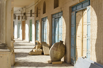 old amphora and shadows under arch in Tunisia city