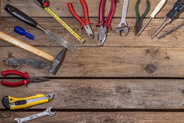 Working tools on wooden rustic background