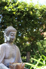 Buddah shows peaceful smile in green background