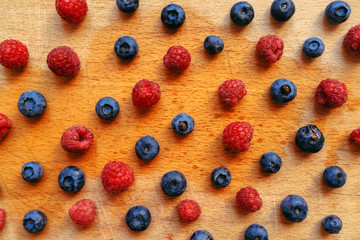 Blueberries and raspberries, healthy forest berry fruit