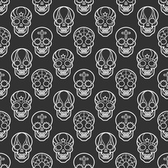 Decorative mexican skulls seamless pattern on black backdrop, vector illustration