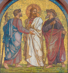 Wall Mural - BERLIN, GERMANY, FEBRUARY - 14, 2017: The mosaic of Jesus with the disciples on the road to Emmaus on the facade of church Emmauskirche by workroom Deutschen Glasmosaik - Gesellschaft Puhl & Wagner.