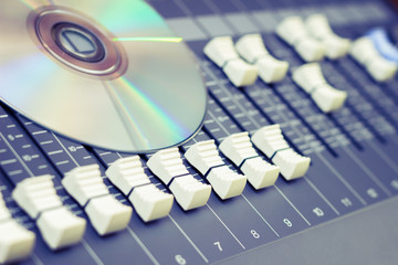 CD on sound mixer, music background