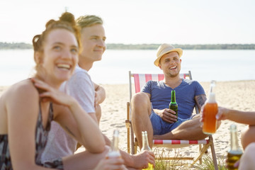 Group of young people relaxing with drinks