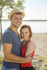 Attractive loving young couple on a beach