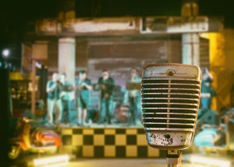 Classic microphone with Abstract blurred Concert stage, Retro styled, vintage filter effect