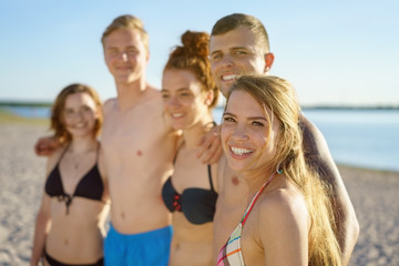Group of young people in a line on the beach