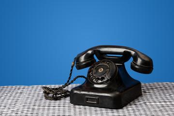 Vintage Landline Phone communication concept blue background