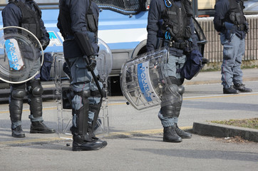 police with shields and riot gear