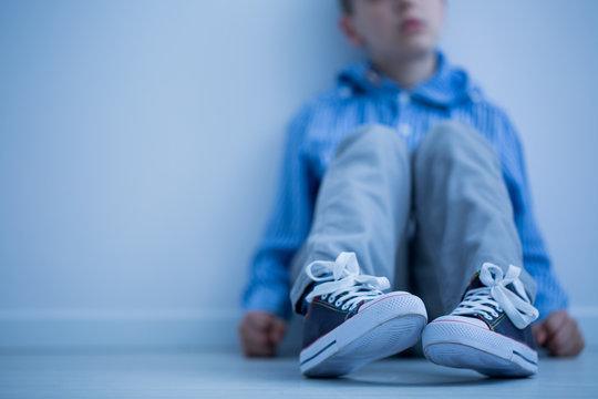 Boy sitting on a floor