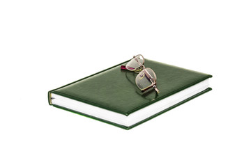 On a white background is a diary and glasses for the eyes