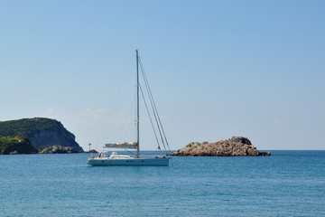 A yacht in the Adriatic sea and the rocky island