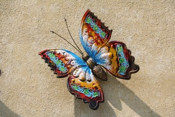 Large metal butterfly on the wall, Italy