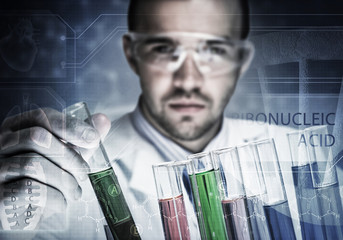 Portrait of concentrated male scientist working with reagents in laboratory