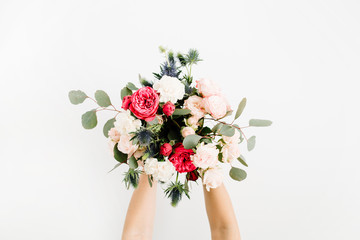 Girl's hands holding beautiful flowers bouquet: bombastic roses, blue eringium, eucalyptus, isolated on white background. Flat lay, top view. Floral composition Fototapete