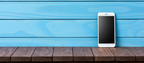 Modern smartphone on wooden background