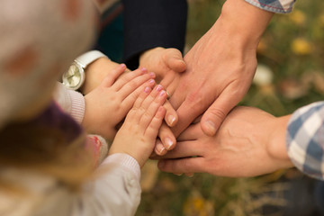 Family concept, Three hands of the family. Unity, support, protection and happiness.