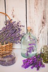 Autocollant pour porte Pique-nique Lavender oil with fresh flowers on wooden background.