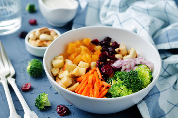 Broccoli carrot cashews apple salad with honey greek yogurt dressing