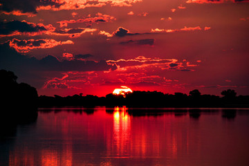Spoed Fotobehang Bordeaux Sunset on the Chobe River, Botswana