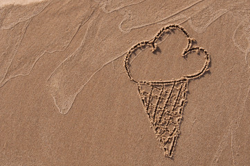 ice cream. Hand drawn with stick on sand on beach. Beach background. Top view