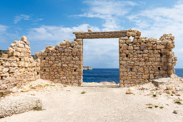 Foto op Textielframe Rudnes The ruins of an ancient building in the picturesque village of Firopotamos on Milos Island. Cyclades, Greece.