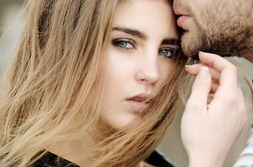 Cute girl with sensual kiss of male lips