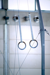 Rings apparatus in a gym. Abstract image symbol of power, strength, training, determination, sport or health.