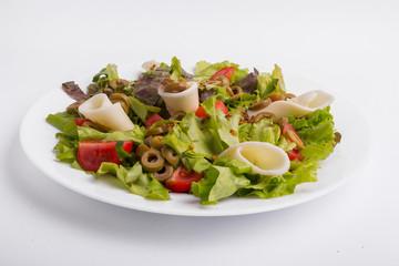 Italian vegetable salad on a white