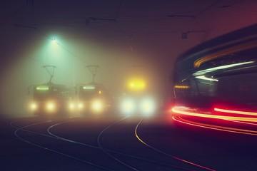 Trams at night in Prague, Czech Republic.