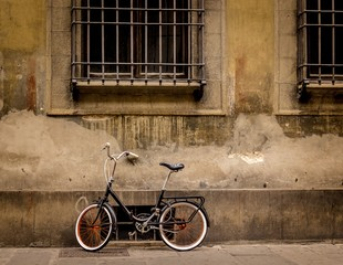 A bicycle on a street in Florence, Italy.