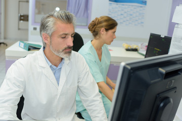 doctors and nurse analyzing medical test