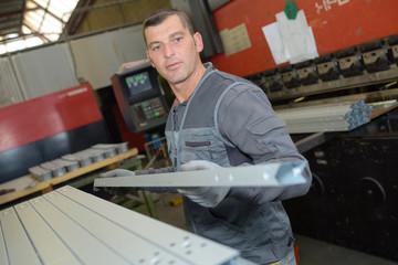 metal worker standing in workshop