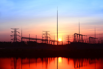 High voltage substation in the setting sun