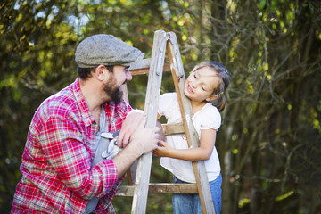 Portrait of father and daughter outdoors, Munich, Bavaria, Germany