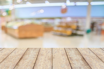 Empty wood table top with Supermarket blurred background