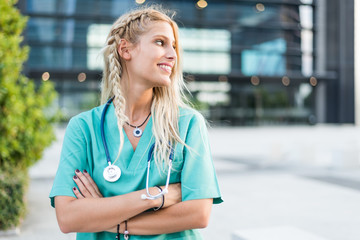 Female doctor, nurse or vet outdoors smiling looking at the camera isolated portrait closeup