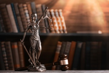 Statue of justice on library background.