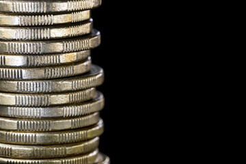 Stack of Coins over Black Background