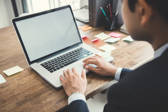 Businessman concentrating on working with notebook computer