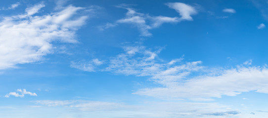 Panorama of blue sky background with white clouds on a sunny day Wall mural