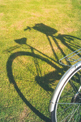 Bicycle with shadows on grass