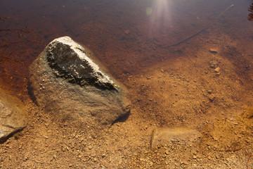 Photo of rock semi sunken on water